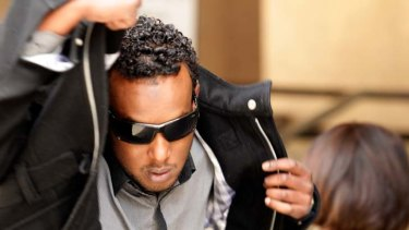 Abdi Farah, outside Melbourne Magistrates Court, is accused of being involved in attacks on two taxi drivers.