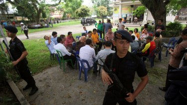 Indonesian police officers guard a church compound following an attack during Sunday Mass in Medan, Indonesia.
