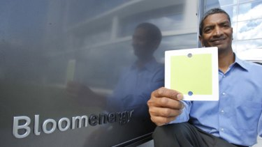 K.R. Sridhar, co-founder and CEO of Bloom Energy, holds up a fuel cell  in front of Bloom Energy power servers at eBay offices in San Jose, California.