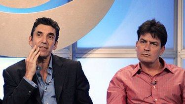 Charlie Sheen (right) and <I>Two and a Half Men</i> creator Chuck Lorre, who has become the focus of his rage over the show's axing.