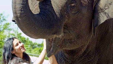 Zoo keeper Lucy Melo pictured alongside elephant Tang Mo in May.