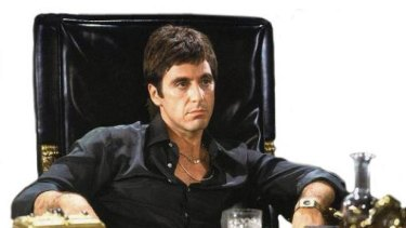 Al Pacino feels the weight of his drug money in <i>Scarface</i>.