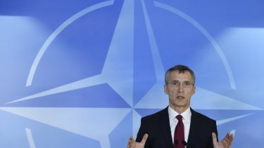 NATO Secretary-General Jens Stoltenberg addresses the media before the meeting of defence ministers in Brussels.