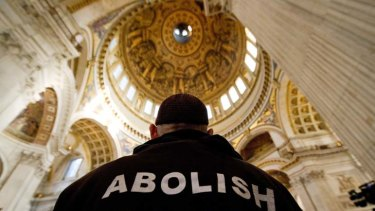 Moral highground ... a protester stands beneath the dome inside St Paul's Cathedral in London.