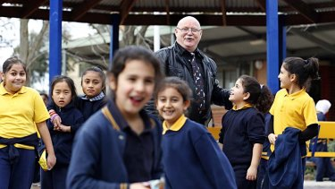 Meadow Heights Primary School principal Kevin Pope with some of his students. Pope believes NAPLAN testing is an 'obscene waste of public funds'.
