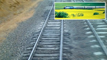 This image of a 'mud hole' on the Melbourne-Sydney line, was provided to The Age after concerns were raised about XPT passenger train (inset) safety.
