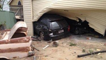Car crashes through Ipswich garage