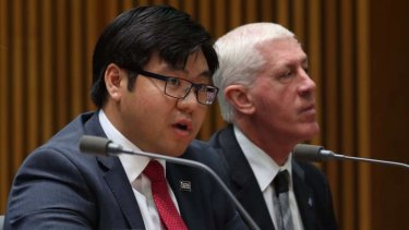 Race discrimination commissioner Dr Tim Soutphommasane with Disability Discrimination Commissioner Graeme Innes who clashed with Attorney-General George Brandis during Senate estimates over the 'downgrading' of Mr Innes' role