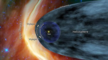 This file artist's concept shows Voyager 1 and Voyager 2 at the edge of the solar system.
