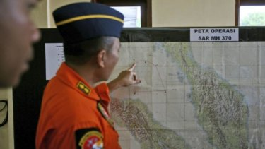 An Indonesia air force officer shows a map of Malacca Straits during a briefing.
