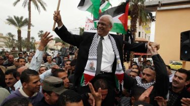 Accusations ... chief Palestinian negotiator Saeb Erekat is carried during a rally upon his return from Cairo to the West Bank city of Jericho, two days ago.
