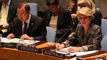 United Nations Secretary-General Ban Ki-moon, left, listens as Australian Foreign Minister Julie Bishop speaks during a Security Council meeting on small arms, at United Nations headquarters.