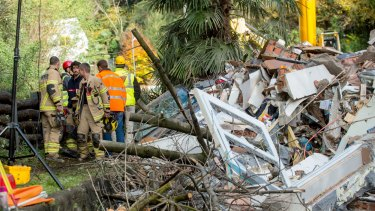 Rescuers at the scene of a landslide  that buried a building in the village of Davesco-Soragno near Lugano, Switzerland on Sunday.
