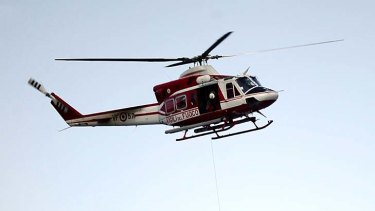 A,n Italian crew member is flown to safety after being rescued.
