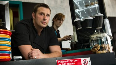 Craig Pearce and Jessie Familetti placed a sign on the counter to ban mobile phones.
