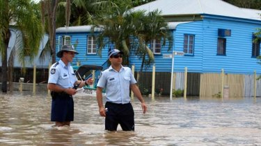 As the floodwaters keep on rising, extra police are called in to protect evacuated homes from looters in Rockhampton.