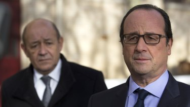 'France has no more hostages, in any part of the world ... French President Francois Hollande, right, flanked by Defence Minister Jean-Yves Le Drian.