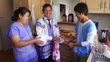 New opportunities … Burmese refugee Gay Htoo Paw, centre, moved his family from Sydney to Albany in search of work.