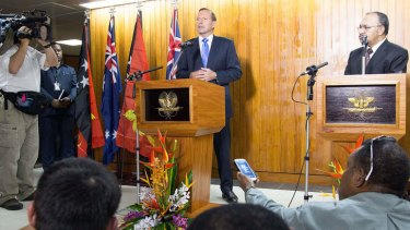 Australian Prime Minister Tony Abbott speaks at a joint press conference with Papua New Guinea's Prime Minister Peter O'Neill.