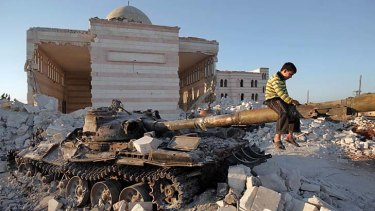 No longer a conflict but a war … a boy plays on a wrecked Syrian army tank north of Aleppo.