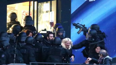 Police storm the building as hostages are freed.