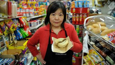 She likes Julia Gillard: Annie Huang at her Carlton North store yesterday.