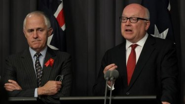 Communications Minister Malcolm Turnbull and Attorney-General George Brandis brief the media on the new legislation on Thursday.