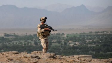 A soldier on patrol in Afghanistan, where Chris Masters sees an uncertain aftermath.