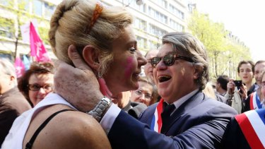 "Political alliance: the anti gay marriage activist ""Frigide Barjot"" embraces National Front MP Gilbert Collard at a demonstration against the bill."