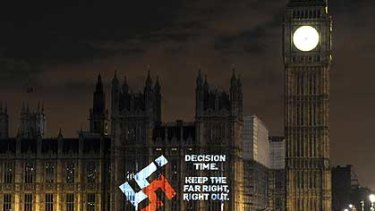 The swastikae projected on to the Houses of Parliament in London.