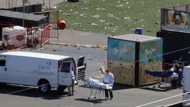 Investigators load a body from the scene of the mass shooting near the Mandalay Bay resort and casino in Las Vegas.