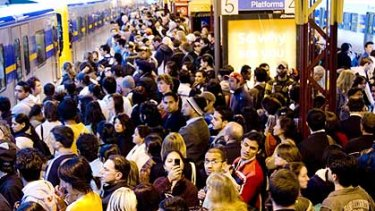 Peak hour commuters cram onto the platforms at Flinders Street station.