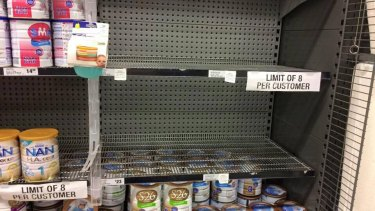 A Woolworths shelf emptied of popular Australian brands. It has imposed an eight-tin limit.
