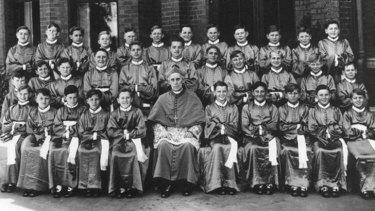 Vienna Mozart Boys Choir with Archbishop Mannix in 1939.