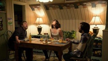 John Goodman as Howard; Mary Elizabeth Winstead as Michelle; and John Gallagher Jnr as Emmett in