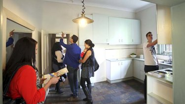 House hunters: Interested buyers inspect a Marrickville property ahead of auction. The house sold for $890,000.