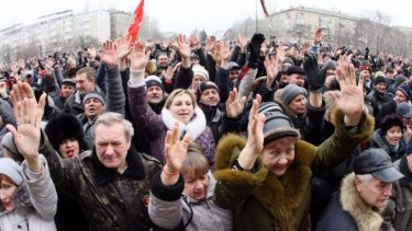 Pro-Russian activists vote during a rally in the centre of the eastern Ukrainian city of Donetsk.