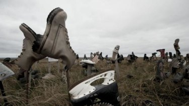 View of boots at the so-called 'Boot hill' --where tourists and locals leave a shoe before leaving the island, according to tradition-- near Stanley, in the Falkland Islands, on March 26, 2012.