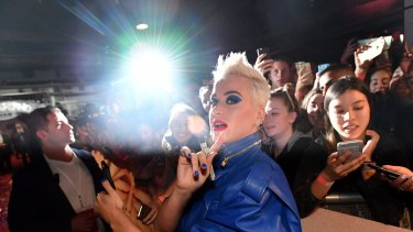 Katy Perry greeting fans at Myer's Sydney City store on Friday.