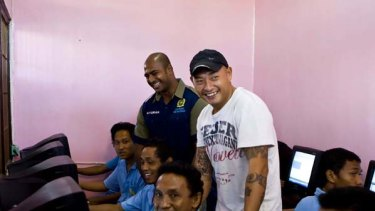 Helping others ... Myuran Sukumaran, left, and Andrew Chan with inmates in Kerobokan prison's computer room.