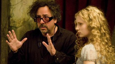 Director Tim Burton, pictured on the set of Alice in Wonderland, was brought in to stage the party for the Obamas.
