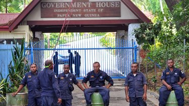Power tussle ... Papua New Guinean Police prevent Prime Minister Peter O'Neill and his supporters from reaching Government House in Port Moresby on Tuesday.