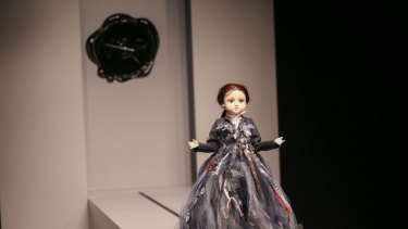 A miniature mannequin traverses the runway at the NGV.