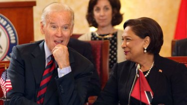 You don't say: US Vice President Joe Biden listens to his host, Trinidad & Tobago's Prime Minister Kamla Persad-Bissessar on Tuesday.