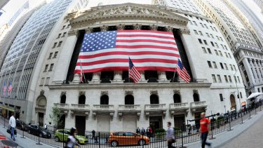A large American flag draped across the front of the New York Stock Exchange earlier this year.