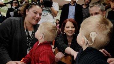PM jokes with Ben and Lochie Baulch at the Taralye Kindergarten for Deaf Children in Blackburn, Melbourne this morning.