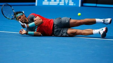 Rafael Nadal takes a tumble during his fourth-round match against Kei Nishikori on Monday.