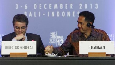 World Trade Organisation director-general Roberto Azevedo (left) is congratulated by conference chairman Gita Wirjawan of Indonesia.
