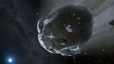 An artist impression of a water-rich asteroid being torn apart by the strong gravity of the white dwarf star GD 61. Scientists say they have found evidence of an apocalypse in another planetary system.