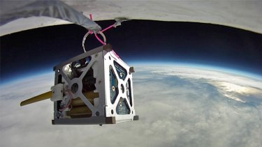 NASA plans to launch three smartphone nanosatellites later this year. Above is the PhoneSat 1.0 during a high-altitude balloon test.